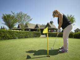 Golfer putting at Lewis Estates golf course