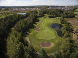 Lewis Estates Golf Course well manicured green and sand bunkers