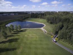 Lewis Estates Golf Course water hazard with golf cart on path
